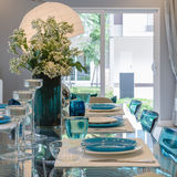 Glass dining table in dinning room Royalty Free Stock Images