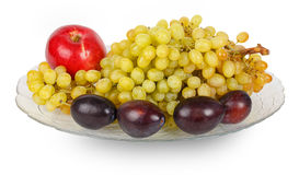 Glass dish with grapes, plums, peaches and apples Stock Images
