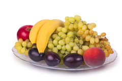 Glass dish with grapes, plums, peaches, bananas and apples Stock Images