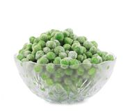 Glass dish with green frozen peas. Royalty Free Stock Images