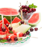 Glass dish with mixed fruit salad and cherry Stock Images