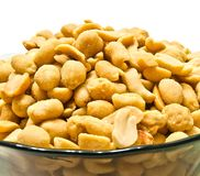 Glass dish with peanuts. On white background Stock Photography