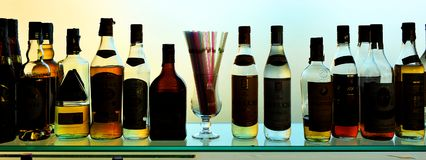 Bottles of wine and liquors at the bar Royalty Free Stock Photos