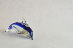 A glass dolphin figurine Stock Images
