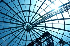Glass dome. A complex modern dome-shaped design of a roof of shopping center Royalty Free Stock Image