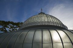 Glass dome. A glasshouse dome dripping in condensation, backlit by the Sun royalty free stock photography