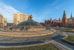 Glass dome crowned by the statue of St. George at the Manege squ. Moscow, Russia. Glass dome crowned with a statue of St. George, patron of Moscow, at the Manege Stock Photo