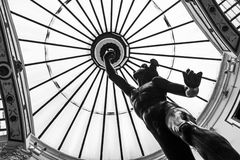 Glass dome and Mercury sculpture in Valladolid Stock Photo