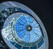 Glass dome of a modern building has a futuristic design round shape. Glass dome of a modern building has a futuristic design stock photography