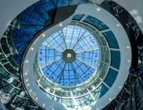 Glass dome of a modern building has a futuristic design round shape. stock photography