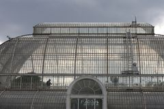The glass dome of the old conservatory in the Royal Botanic Gardens Kew. Against the gray sky. London, UK royalty free stock photography