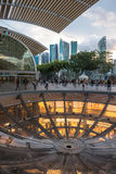 Glass Dome and skyline view at The Shoppes. Singapore, Singapore - September 12, 2014: Reverse glass dome exposing The Shoppes below the street. With skyline Royalty Free Stock Image