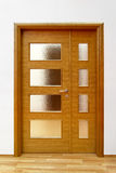 Glass door. Double glass house door with wooden frame royalty free stock images