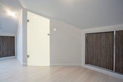Glass door in the attic Stock Photo