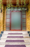 Glass door with building exterior is sandstone. Stock Photos