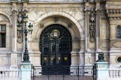 Glass door - Hotel de Ville. Architectural details with Rod Iron glass door - Hotel de Ville, Paris Royalty Free Stock Photo