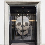 Skull on glass door Royalty Free Stock Image