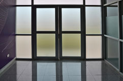 Glass door and wall of building. Frosted glass door and wall of building interior Stock Photos