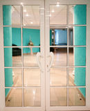 Glass doors with green tilt Stock Images