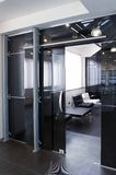 Glass doors in the new office stock images