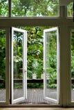 The open glass door stock photography