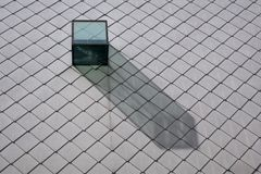 Glass dormer in a slate roof. Throwing a shadow on the slate stones Stock Image
