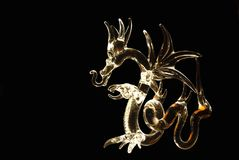 Glass dragon illuminated Royalty Free Stock Images
