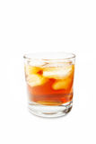 Glass with a drink. And ice on a white background Stock Image