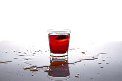 Glass drink alcohol with ice cube Stock Images