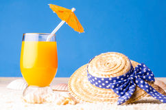 Glass of drink at beach Stock Photography