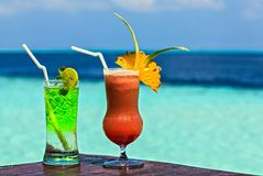Glass of drink is on a beach table Royalty Free Stock Photography
