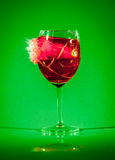 Glass with drink by bullet Stock Photo