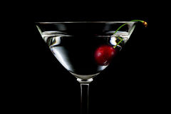 Glass of drink with cherry closeup isolated on black Stock Photos