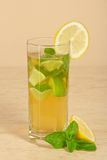 Glass with drink is decorated of lemon slice Royalty Free Stock Photos