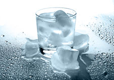 Glass with a drink and ice. On a white background Stock Images