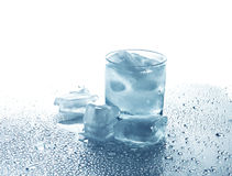 Glass with a drink and ice Royalty Free Stock Photography