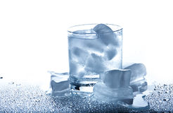 Glass with a drink and ice. On a white background Royalty Free Stock Images