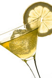 Glass with drink, ice cube and lemon Royalty Free Stock Photos
