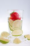 Glass Of Drink With Ice Cubes And Fruits On White Royalty Free Stock Images