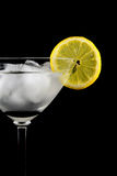 Glass of drink with ice and lemon slice close-up isolated on a black Royalty Free Stock Image