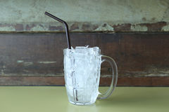 Glass of drink with ice placed on table. Stock Images