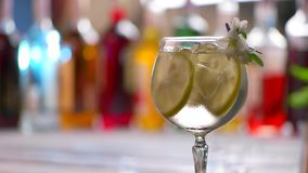 Glass of drink slowly rotates. stock video footage