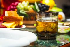 A glass of drink on the table with fruit Stock Photos