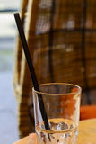 Glass with drinking straw in it Stock Images
