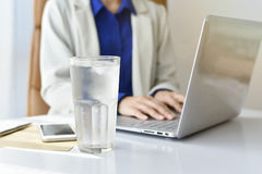 A glass of drinking water on office desk Royalty Free Stock Images
