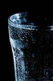 Glass with drops. Photo of glass of water with drops isolated on black background Stock Photos