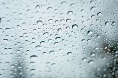 Glass with drops of the rain. Glass with drops of rain water close up stock photography