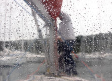 Through glass with drops of water Royalty Free Stock Photos