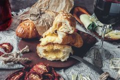 A glass of dry red wine and Italian Focaccia bread with cheese and olive oil and sun dried tomatoes. Selective focus. The horizontal frame Royalty Free Stock Photos