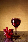 Glass of dry wine and red grapes Royalty Free Stock Images